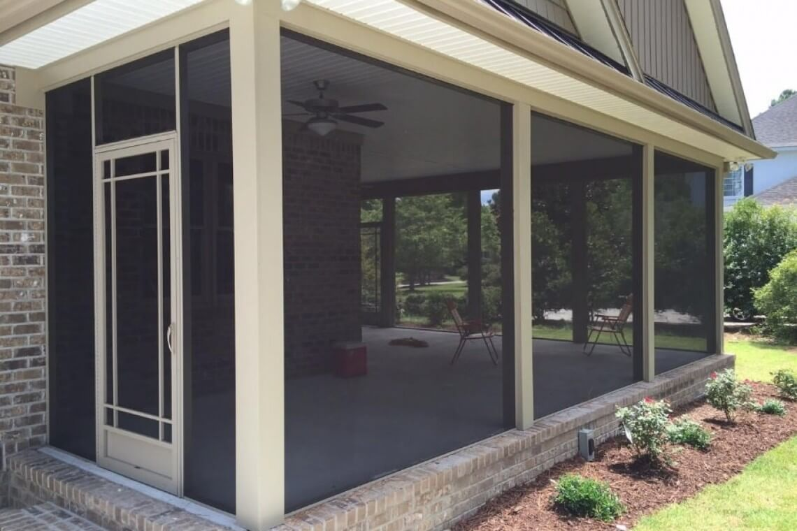 A white framed screened in porch enclosure.