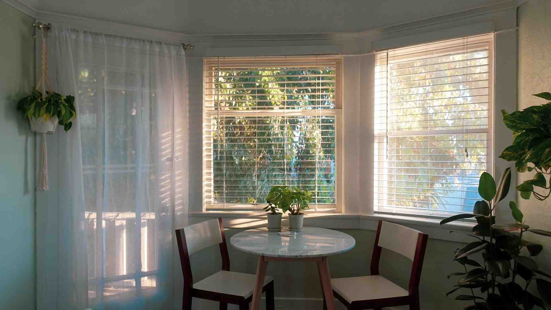 Breakfast nook with a bay windows and white blinds